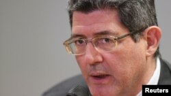 """FILE - Brazilian Finance Minister Joaquim Levy said losing the investment grade rating was """"serious"""" and showed the government had not done everything required."""
