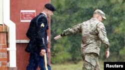 Sgt. Robert B. Bergdahl (L) leaves the court house for a lunch break during his hearing in the case of United States vs. Bergdahl in Fort Bragg, North Carolina, U.S., Oct. 16, 2017.