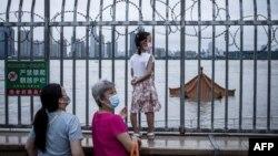 Pandemiija koronavirusa u Kini (Foto: AFP/STR)