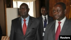 Djotodia, left, leader of the Seleka rebel alliance, beside now-exiled CAR President Francois Bozize, Libreville, Jan. 11, 2013.