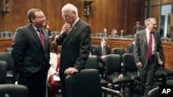 FILE - Brian Benczkowski, Senate Judiciary committee minority staff director, left, talks with committee chairman Sen. Patrick Leahy, D-Vt. on Capitol Hill in Washington, June 11, 2009.