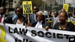 Mercy Wambua (C), CEO of the Law Society of Kenya, and other lawyers march to demand that court orders and the law are respected, following the government's deportation last week of an opposition politician in defiance of a court order that he be produced in court, in downtown Nairobi, Kenya, Feb. 15, 2018.