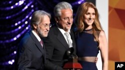 Neil Portnow, president and CEO of the Recording Academy, from left, Trustees Award recipient Humberto Gatica and Celine Dion pose on stage at the Lifetime Achievement and Trustees Awards presentation at the Ka Theater in the MGM Grand Hotel, Nov. 18, 2015.