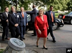 FILE - Chile's President Michelle Bachelet arrives to commemorate Chilean political figure and activist Orlando Letelier who was assassinated in 1976 by secret agents of the government of Chilean strongman Augusto Pinochet, June 23, 2009, in Washington.