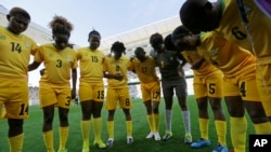 FILE: Zimbabwe's players confer prior to their group B match of the women's Olympic football tournament between against Canada in Sao Paulo, Brazil, Saturday, Aug. 6, 2016. (AP Photo/Nelson Antoine)