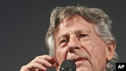 Polish-born film director Roman Polanski speaks as he picks up the award for his life work at the Film Festival in Zurich, Swzitzerland, Sept.27, 2011