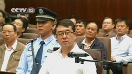 Former police chief Wang Lijun speaks during a court hearing in Chengdu in this still image taken from video on September 18, 2012.
