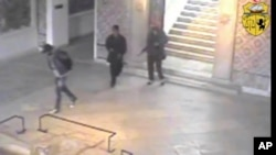 FILE - In this frame made from CCTV and released by the Tunisian government, two gunmen and third unidentified man can be seen inside the Bardo museum in Tunis, March 18, 2015.