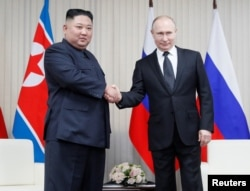 Russian President Vladimir Putin (R) and North Korean leader Kim Jong Un shakes hands during their talks at Far East Federal University on Russky Island in Vladivostok, Russia, Apr. 25, 2019.