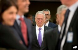 FILE - U.S. Secretary for Defense Jim Mattis arrives for a meeting of NATO defense ministers at NATO headquarters in Brussels, June 29, 2017.