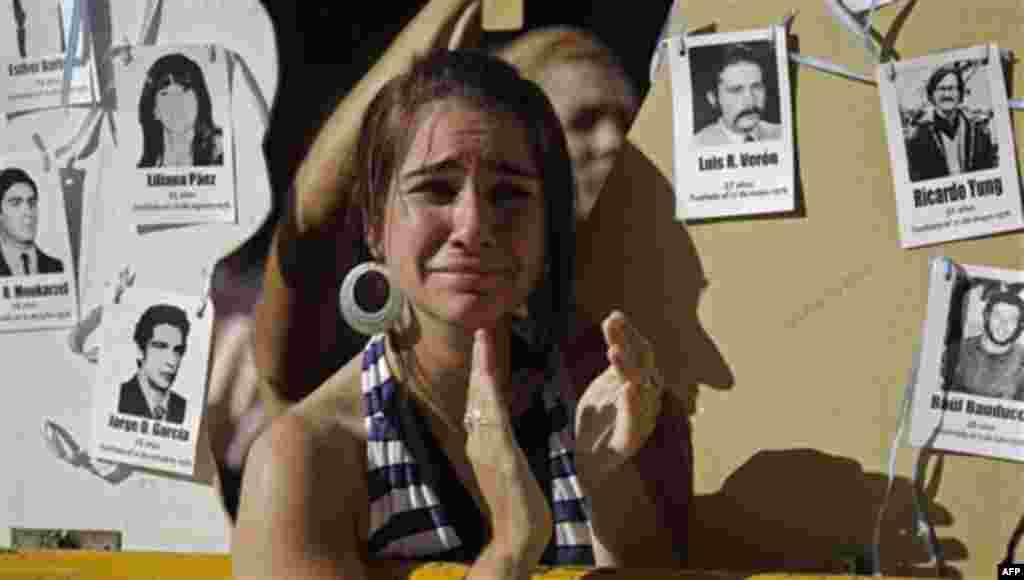 The relative of a victim killed during Argentina's dirty applauds as she listens to the sentence for former dictator Jorge Videla in Cordoba, Argentina, Wednesday Dec. 22, 2010. Videla was sentenced to life in prison Wednesday for the torture and murder