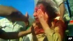 Amaterski video Moamera Gadafija okruženog libijskim borcima u Sirti