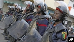 Riot policemen stand in a row to block access to Independence Square during an opposition demonstration against Senegal's President Abdoulaye Wade's controversial third term bid for presidency in Dakar February 24, 2012.