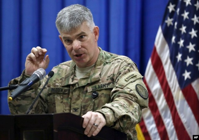FILE - Col. Steve Warren speaks to reporters during a news conference at the U.S. Embassy in the heavily fortified Green Zone in Baghdad, Iraq.