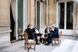 From left, Emirati Foreign Minister Sheikh Abdullah bin Zayed al-Nahyan, Saudi Arabia's Foreign Minister Prince Saud al-Faisal, Jordanian Foreign Minister Nasser Judeh and U.S. Secretary of State John Kerry discuss the crisis in Paris, France, June 26, 20
