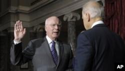 Vice President Biden, right, reenacts swearing in of Sen. Leahy, D-Vt., as President Pro Tempore of the Senate, Washington, Dec. 18, 2012.