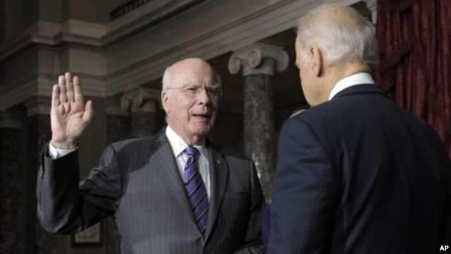Vice President Biden, right, reenacts swearing in of Sen. Leahy, D-Vt., as President Pro Tempore of the Senate, Washington, Dec. 18, 2012.