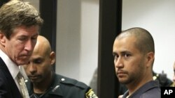 Attorney Mark O'Mara (L) looks on George Zimmerman (R) makes his first appearance on second degree murder charges in the shooting death of Trayvon Martin in courtroom J2 at the Seminole County Correctional Facility in Sanford, April 12, 2012.