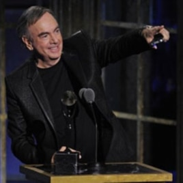 Inductee Neil Diamond accepts his trophy at the Rock and Roll Hall of Fame induction ceremony