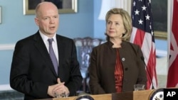 Secretary of State Hillary Rodham Clinton, right, hosts a meeting with British Foreign Secretary William Hague, at the State Department in Washington, Wednesday, Nov. 17, 2010. Hague used this month's British presidency of the UN security council today to