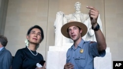Myanmar leader Aung San Suu Kyi tours the Lincoln Memorial with National Park Service ranger Heath Mitchell in Washington, Sept. 14, 2016.