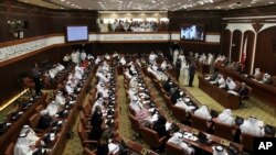 FILE- In this July 28, 2013 file photo, Bahraini lawmakers participate in a special session of parliament to discuss how to handle the uprising in the Gulf island kingdom, convened in Manama, Bahrain.