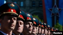 Russian servicemen march during a Victory Day Parade in Moscow's Red Square on May 9, 2014.