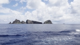 A group of disputed islands known as Senkaku in Japan and Diaoyu in China is seen from the city government of Tokyo's survey vessel in the East China Sea, September 2, 2012.