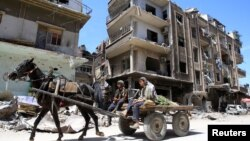 Wani bangaren garin Douma dake kusa da Damascus, Syria, inda ake zargin gwamnatin kasar ta kai hari da makaman guba