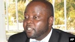 FILE - Paul Mphwiyo, shown in July 2013, was shot in September 2013.