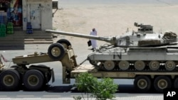 FILE - A Saudi tank being transported, in the city of Najran, Saudi Arabia, near the border with Yemen, April 23, 2015.