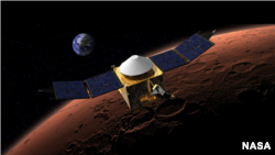 Artist's conception of NASA's MAVEN arriving at Mars. (NASA)