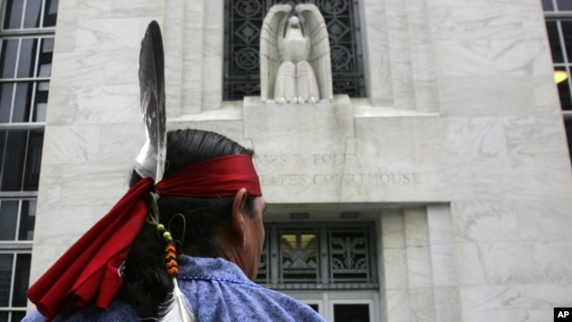 FILE - Jake Edwards, of the Onondaga Council of Chiefs, stands outside the federal courthouse in Albany, N.Y., Oct. 11, 2007, after arguments were heard in the Onondaga Indian Nation's land claim case against New York state.