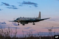 FILE - A photo taken on July 23, 2006 shows an Russian IL-20M plane landing at an unknown location.