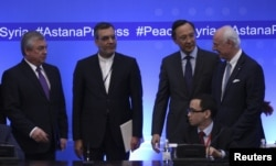 FILE - Russian lead negotiator on Syria Alexander Lavrentyev, Iranian Deputy Foreign Minister Hossein Jaberi Ansari, Kazakh Foreign Minister Kairat Abdrakhmanov and U.N. Special Envoy for Syria Staffan de Mistura attend the fourth round of Syria peace talks in Astana, Kazakhstan.