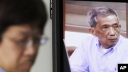 "Kaing Guek Eav, also known as Duch, who ran the notorious Toul Sleng, a top secret detention center for the worst ""enemies"" of the state, appears on a television screen of the press center of the U.N.-backed war crimes tribunal in Phnom Penh, 2010."