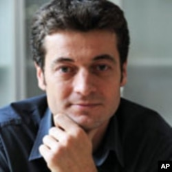 Jean Francois Julliard, Secretary General of Reporters Without Borders, is questioning the efficacy of the French government's efforts to secure the release of two French journalists captured in Afghanistan