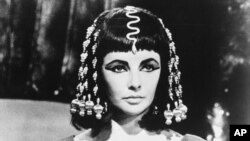 "Actress Elizabeth Taylor poses as Queen Cleopatra in this photo from Joseph L. Mankiewiez' 1963 film, ""Cleopatra."""