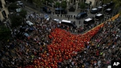 Firefighters join protesters outside the Spanish government delegation during a one-day strike in Barcelona, Spain, Tue sday Oct. 3, 2017.