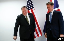 U.S. Secretary of State Mike Pompeo, left, poses with Britain's Foreign Secretary Jeremy Hunt at the European Council in Brussels, Belgium, May 13, 2019.