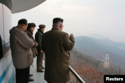 North Korean leader Kim Jong Un watched the ground jet test of a Korean-style high-thrust engine newly developed by the Academy of the National Defence Science in this undated picture provided by KCNA in Pyongyang, March 19, 2017.