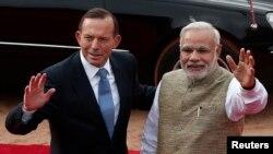 澳大利亞總理阿博特(左)9月7日訪問印度時,與印度總理莫迪(右)轉新德里會面。