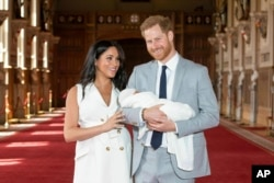 Britain's Prince Harry and Meghan, Duchess of Sussex, introduce their newborn son, Archie, to the world at Windsor Castle, south England, May 8, 2019.