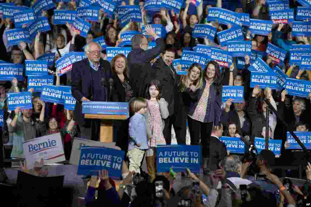 Democratic presidential candidate Sen. Bernie Sanders, I-Vt., his wife Jane Sanders, his son Levi Sanders, and members of their family arrive to cheers during a primary night rally in Essex Junction, Vermont, March 1, 2016.
