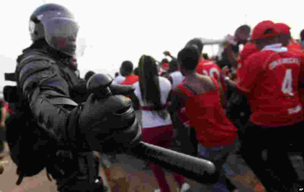 "Equatorial Guinea's special police forces try to control Equatorial Guinea fans inside Estadio de Bata ""Bata Stadium"", which will host the opening match and ceremony for the African Nations Cup, in Bata January 21, 2012."