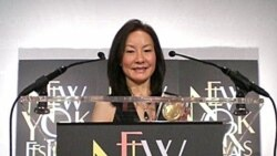 VOA reporter June Soh with a Bronze Medal from the New York Festivals Television & Film Awards