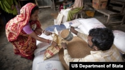Targeted food distribution by USAID partner Save the Children in Barisal region of Bangladesh. Aid programs should be viewed as an investment, Kerry said.