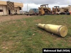 Unexploded ammunition lies in village near Kobani. Credit: Mahmoud Bali.