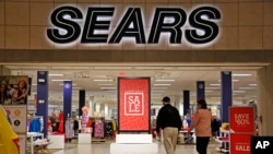 "FILE - Shoppers walk into a Sears store in Pittsburgh, Pennsylvania, Feb. 8, 2017. Sears said that there is ""substantial doubt"" that it will be able to remain in business. The company, which runs Kmart and its namesake stores, has struggled for years with weak sales."