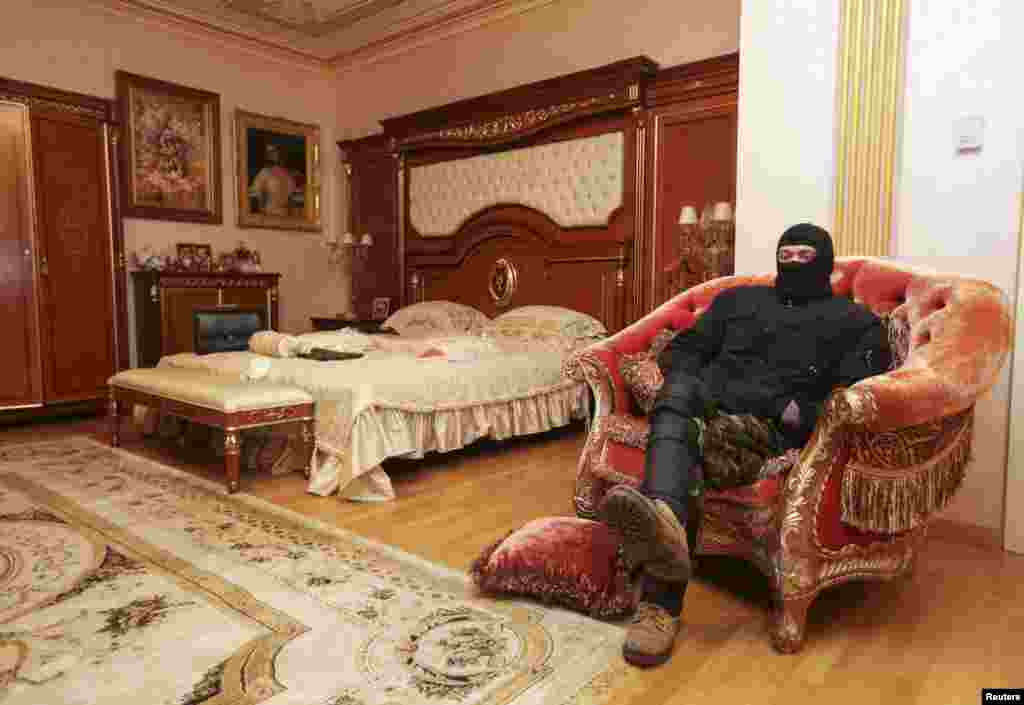 A man sits on a chair in the house of Ukraine's former prosecutor general Viktor Pshonka in the village of Gorenichy outside Kyiv.
